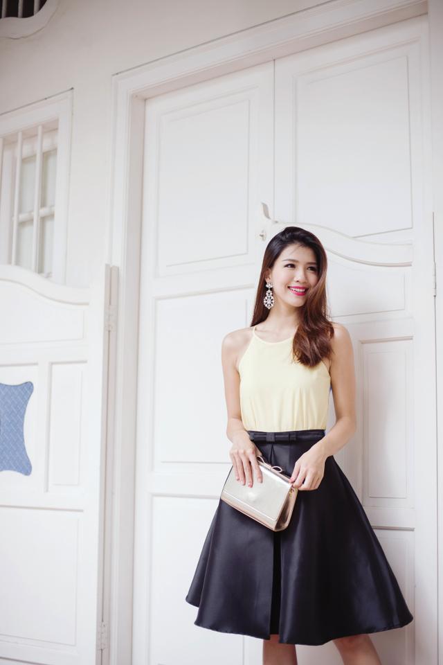 The New Maryann Bow Midi Skirt in Black