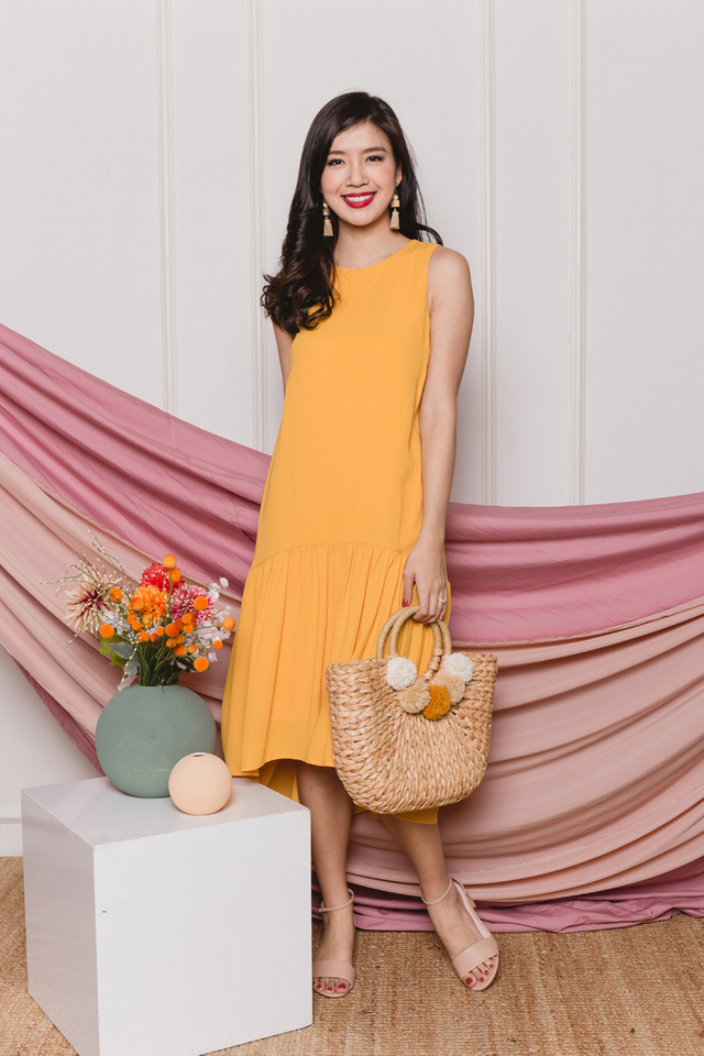 Della Drop Hem Dress in Sunshine
