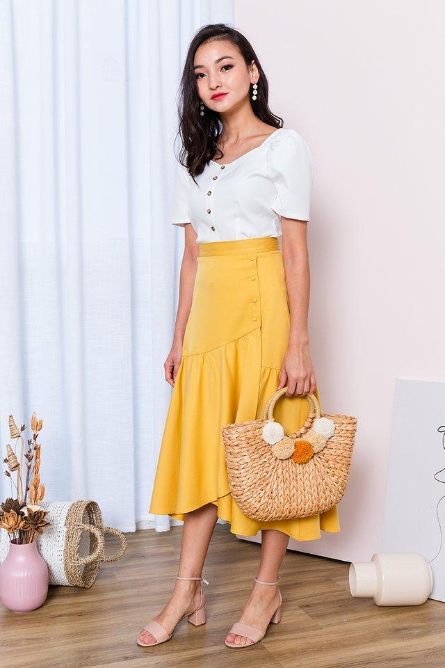 Ariel Asymmetrical Buttons Skirt in Mustard